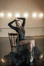 Contemporary ballet dancer on a wooden chair on a repetition Royalty Free Stock Photo