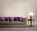 Contemporary classic living room beige leather sofa with purple red cushions Royalty Free Stock Image