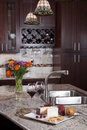 Contemporary custom kitchen modern house new luxury and refreshments on exotic granite countertop Royalty Free Stock Image