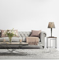 Contemporary elegant chic living room with grey tufted sofa Royalty Free Stock Photo