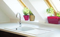 Contemporary kitchen sink near window Royalty Free Stock Images