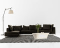 Contemporary minimal black leather sofa with striped rug and floor lamp Royalty Free Stock Images