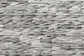 Contemporary wall of light grey, natural stone. Texture Royalty Free Stock Photo