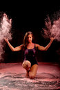 Contemporary dance girl throwing pink powder Royalty Free Stock Photo