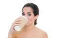 Content bare brunette drinking from disposable cup on white background Royalty Free Stock Photo