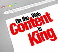 Content is king website screen increase traffic more articles fe the words on a computer to illustrate the importance of fresh or Stock Photography