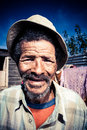Content senior smiling old african men outdoors wearing an old khaki hat Stock Images