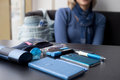 Contents of the women s purse on the table in blue Royalty Free Stock Photography
