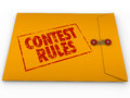 Contest rules classified envelope terms conditions entry form words stamped on a yellow to illustrate and for a raffle competition Stock Images