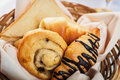 Continental breakfast with assortment of pastries and fresh Royalty Free Stock Images