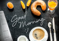 Continental breakfast on black chalkboard good morning poster design with background bar morning menu coffee orange juice crescent Royalty Free Stock Images