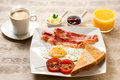 Continental breakfast with coffee and orange juice close up of on wooden table Royalty Free Stock Photography