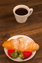 Continental breakfast with croissant, coffees and fresh strawberries. Royalty Free Stock Photo