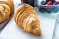 Continental breakfast fresh croissant and berry fruits Stock Photo