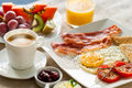 Continental breakfast with fresh fruit close up of healthy and ground coffee Royalty Free Stock Photography