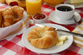 Continental breakfast on a picnic table Royalty Free Stock Images