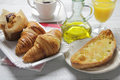Continental breakfast traditional with toast croissants muffins coffee orange juice and olive oil Stock Photo