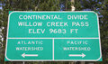 Continental divide sign for the and the pacific and atlantic watersheds at willow creek pass on the county line between jackson Stock Images