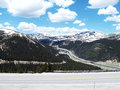 Continental divide view of interstate on colorado as it climbs toward the eisenhower tunnel which travels under the thousands of Royalty Free Stock Image
