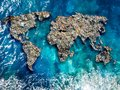 Continents earth are made up of garbage, surrounded by ocean water. Concept environmental pollution with plastic and Royalty Free Stock Photo