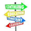 Continuing education constant learning street signs the words on four colorful road or to illustrate the importance of school and Stock Images