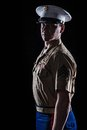 Contour shot of us marine in blue dress uniform on black background Royalty Free Stock Photo