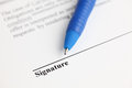Contract ready for signature ballpoint pen on focus on the end of ballpoint pen shallow depth of field close up Royalty Free Stock Photo