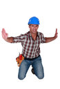 Contractor being squeezed by invisible pressure Royalty Free Stock Images