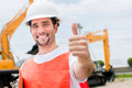 Contractor with thumbs up happy at a building site Royalty Free Stock Images