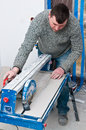 Contractor with tile cutting machine Royalty Free Stock Photos