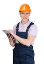 Contractor writing on a tablet with documents builder in orange headpiece isolated white Stock Photos