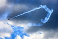 Contrails vapor trail aircraft exhaust stormy or condensation or trails are long thin artificial clouds that form by water and air Royalty Free Stock Image