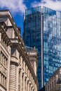 Contrast of old and new buildings in London`s financial district Royalty Free Stock Photo