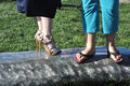 Contrasting footware spike heeled shoes vs flip flops Royalty Free Stock Photo