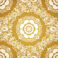 Contrasting seamless pattern with large flowers curls and leaves white lace ornament on a gold background it can be used for Stock Images