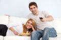 Control couple focus home remote selective tv watching young Στοκ Εικόνες