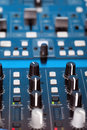 Control knobs on the console of a DJ deck Royalty Free Stock Photo