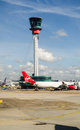 Control tower heathrow airport london england october virgin atlantic plane parked beside the main at Stock Photo