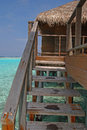Convenient direct access to your private overwater villa bungalow after snorkeling in the beautiful sea via wooden stairs Royalty Free Stock Photo