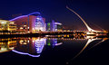 Convention center and samuel beckett bridge in dublin city centre ireland july barrel shaped the ccd by architect santiago Stock Image