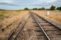 Converging Railroad Road Tracks Royalty Free Stock Photo