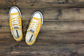 Converse shoes bangkok thailand august yellow on wooden planks Stock Image