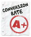 Conversion rate grade lined paper successful sales percentage words on student with a of a plus stamped on it to illustrate a good Royalty Free Stock Photos