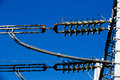 Converter station electrical ceramic insulators specialist on wiring in a special type of transformer substation blue sky Royalty Free Stock Photography