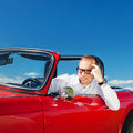Convertible car handsome man looking out on his Stock Image