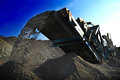 Conveyor belt mining crusher from dumping crushed gravel at mine Stock Photo