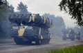 A convoy of military equipment is moving along the road Royalty Free Stock Photo