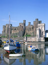 Conwy castle and river medieval in north wales with moored boats Royalty Free Stock Image