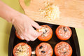 Cook adds cheese to stuffed tomato Royalty Free Stock Photo
