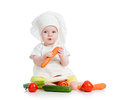 Cook baby girl eating healthy food on white Stock Images